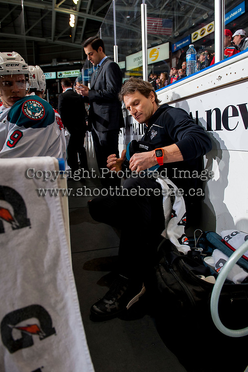 KELOWNA, CANADA - JANUARY 30: Kelowna Rockets' athletic therapist Scott Hoyer kneels on the bench against the Medicine Hat Tigers on January 30, 2017 at Prospera Place in Kelowna, British Columbia, Canada.  (Photo by Marissa Baecker/Shoot the Breeze)  *** Local Caption ***