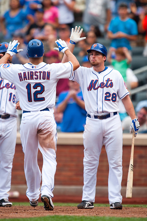NEW YORK - JULY 16: Scott Hairston #12 of the New York Mets is congratulated by teammates after hitting a home run during the game against the Philadelphia Phillies at Citi Field on July 16, 2011 in the Queens borough of Manhattan. (Photo by Rob Tringali) *** Local Caption *** Scott Hairston