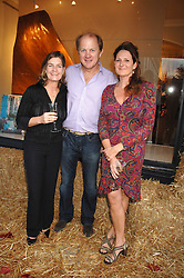 Left to right, EMILY TODHUNTER, ORLANDO HARRIS and KATHRYN IRELAND at a party to celebrate the publication of Country Living by Kathryn Ireland held at Blanchards, 86-88 Pimlico Road, London SW1 on 25th September 2007.<br />