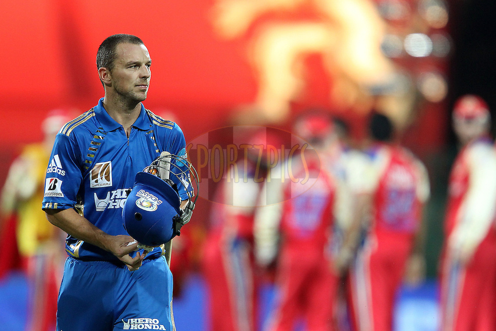 Davy Jacobs leaves the field as RCB celebrate his wicket during match 8 of the the Indian Premier League ( IPL ) Season 4 between the Royal Challengers Bangalore and the Mumbai Indians held at the Chinnaswamy Stadium, Bangalore, Karnataka, India on the 12th April 2011..Photo by Ron Gaunt/BCCI/SPORTZPICS