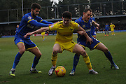 Oxford United midfielder Callum O'Dowda tries to fend off Barry Fuller (Captain) and George Francomb of AFC Wimbledon during the Sky Bet League 2 match between AFC Wimbledon and Oxford United at the Cherry Red Records Stadium, Kingston, England on 27 February 2016. Photo by David Vokes.
