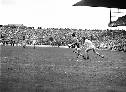 Roscommon runs in possession off the ball as he is chased by Armagh during the All Ireland Senior Gaelic Football Semi Final Replay Roscommon v Armagh in Croke Park on the 28th August 1977. Armagh 0-15 Roscommon 0-14.