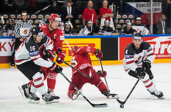Mitch Marner of Canada and Tyson Barrie of Canada vs Andrei Stas of Belarus and Sergei Drozd of Belarus during the 2017 IIHF Men's World Championship group B Ice hockey match between National Teams of Belarus and Canada, on May 8, 2017 in Accorhotels Arena in Paris, France. Photo by Vid Ponikvar / Sportida
