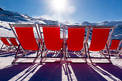 French Alps. Les Trois Vallées, Savoie, France. Rows of Red Sun Loungers