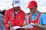 Stewart Hagestad (USA) signs a flag for one of the caddies during the Sunday Singles in the Walker Cup at the Royal Liverpool Golf Club, Sunday, Sept 8, 2019, in Hoylake, United Kingdom. (Steve Flynn/Image of Sport)