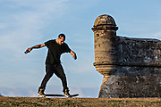Skate boarder at the Castillo de San Marcos in St. Augustine, Florida. St Augustine is the oldest city in America.