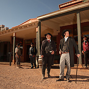 Actors walk the streets of Tombstone in character between re-enactments of the infamous gunfight at the OK Corral in Tombstone, Arizona. In foreground: On left, Kirk Opperman as Wyatt Earp and on right, Erik Servia as Doc Holliday.