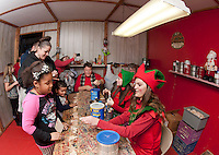 A visit to Santa's Workshop where Shia Rankin along with her mom Ellen Castro wait for their special ornament  made by Santa's elves during opening night festivities at the annual  Christmas Village in Laconia.  (Karen Bobotas/for the Laconia Daily Sun)