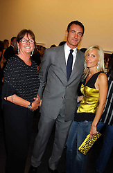 Left to right, MRS HILARY JEFFERIES, her son TIM JEFFERIES and ALEXANDRA VON FURSTENBURG who is separated from her husband Austrian Prince Alexander von Furstenberg  at a party to celebrate the opening of an exhibition of photographs by the late Norman Parkinson held at Hamiltons gallery, 13 Carlos Place, London W1 on 14th September 2004.<br />