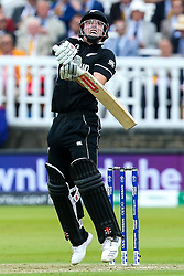 Henry Nicholls of New Zealand fends off a short ball from Mark Wood of England - Mandatory by-line: Robbie Stephenson/JMP - 14/07/2019 - CRICKET - Lords - London, England - England v New Zealand - ICC Cricket World Cup 2019 - Final