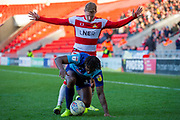 Kieran Sadlier of Doncaster Rovers battles with Anthony Stewart of Wycombe Wanderers during the EFL Sky Bet League 1 match between Doncaster Rovers and Wycombe Wanderers at the Keepmoat Stadium, Doncaster, England on 29 February 2020.