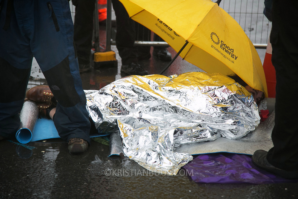 Day two of the Rolling Resistance, Preston New Road, Lancashire. Security violently try to prevent climate protectors to lock-on at the gates to Quadrilla drill site. Two activists managed to lock themselves down and block the gates. A lock-on, where two or more lock themselves together inside a re-inforced tube is used as a peaceful non-violent way of protesting. The New Preston Road Quadrilla site is almost ready to start drilling for shale gas after many delays caused by local objections. Lancashire County council voted against fracking but the conservative central government forced it through.