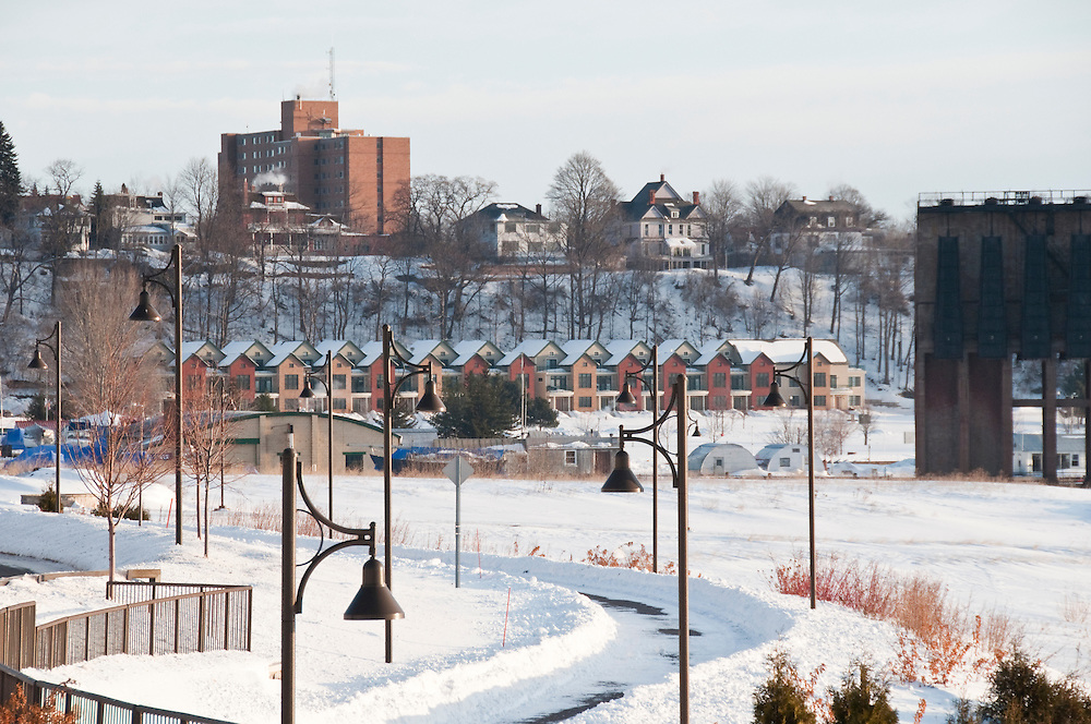 Lake front condos and a bike and walking path in Marquette Michigan in winter.