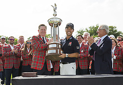 May 26, 2019 - Fort Worth, TX, USA - Kevin Na is awarded the Marvin Leonard Trophy after winning the 2019 Charles Schwab Challenge PGA at Colonial Country Club. (Credit Image: © Erich Schlegel/ZUMA Wire)