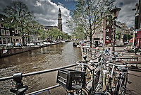 Bikes along the canal near Westerkerk Church, Amsterdam.