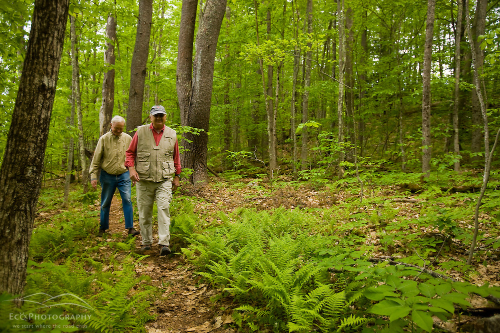 York Land Trust members walk a woodland trail at Highland Farm in York, Maine.