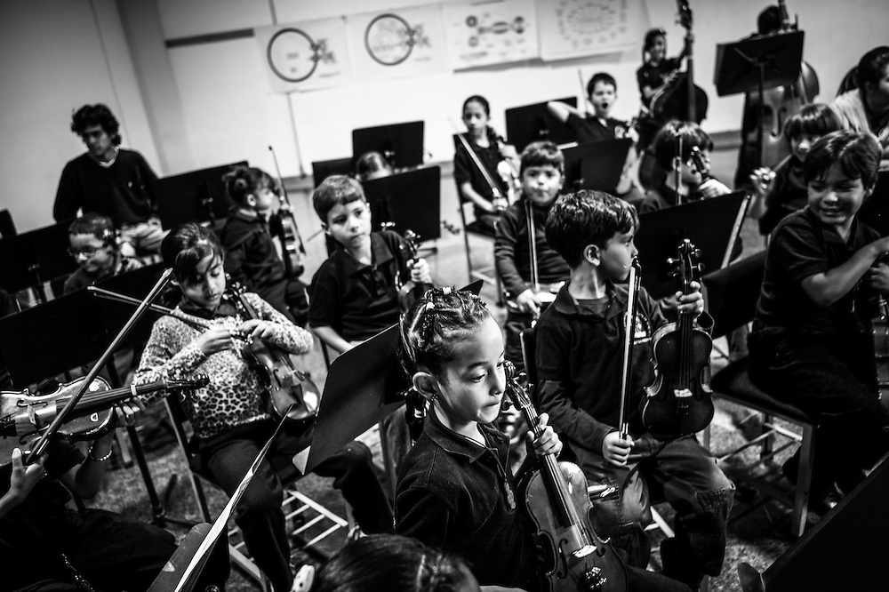 Students learn to play classical music at the La Rinconada nucleo, of the El Sistema music program in Caracas, Venezuela.