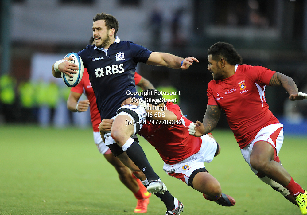 Alex Dunbar - Scotland centre evades Tonga fly half Latiume Fosita<br /> Scotland v Tonga, Rugby Park, Kilmarnock, Scotland, Saturday 22 November 2014<br /> Please credit: Fotosport/David Gibson.