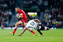 England Winger Anthony Watson is challenged by Fiji Inside Centre Gabiriele Lovobalavu  - Mandatory byline: Rogan Thomson/JMP - 07966 386802 - 18/09/2015 - RUGBY UNION - Twickenham Stadium - London, England - England v Fiji - Rugby World Cup 2015 Pool A.