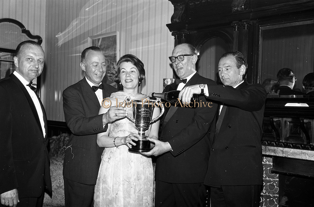 08/05/1964<br /> 05/08/1964<br /> 08 May 1964<br /> Reception and buffet dinner-dance for 5th Annual Tara Cup Rotterdam - Dublin Air Rally given by J.H. Van Anrooy at the Glencormac House Hotel, Co. Wicklow. Picture shows Mr. R. Uges, (second from right) President of the Hague Aero Club, presenting the Tara Cup to Mr. A. Schoemakers, (second eft) of Hilversum, Holland, winner of the Air Rally. Also in the picture are Mrs Rene de Monchy of Rotterdam, a passenger in the winning plane; Mr. J.H. Van Anrooy, Kilmacanogue, Co. Wicklow, host and doner of the Tara Cup (right) and Mr. Robert Mangee, (left) Co-pilot.