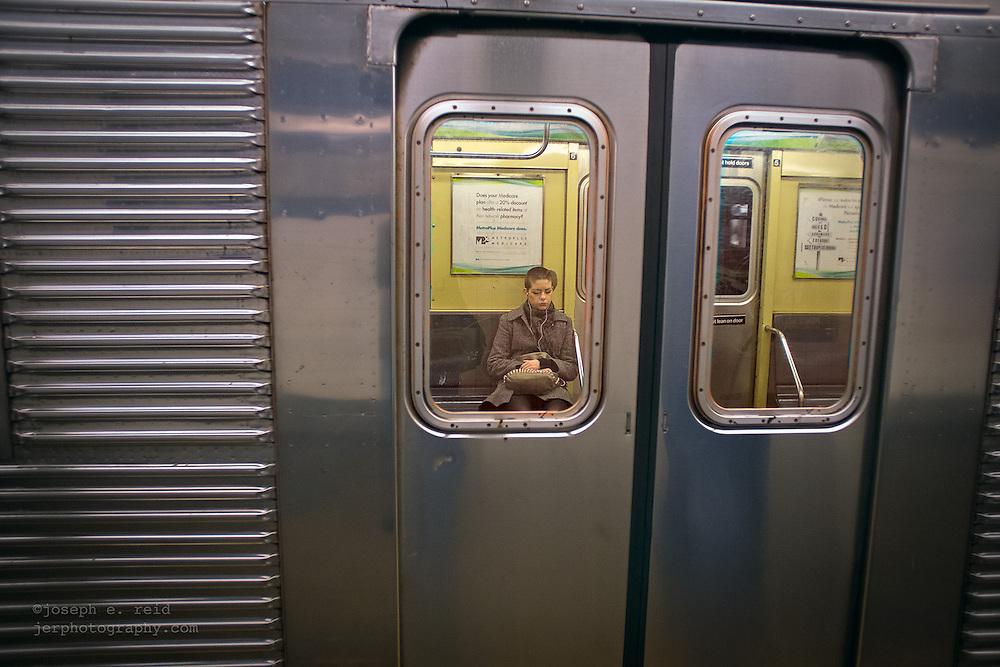 Subway rider seen through window
