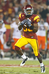 September 11, 2010; Los Angeles, CA, USA;  Southern California Trojans wide receiver Ronald Johnson (83) makes a pass reception against the Virginia Cavaliers during the first quarter at the Los Angeles Memorial Coliseum.