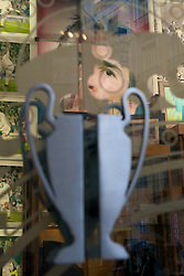 MADRID, SPAIN - Wednesday, October 22, 2008: An image of Real Madrid star Raul looks out over door handles shaped as the European Cup at the Real Madrid shop in Madrid. (Photo by David Rawcliffe/Propaganda)