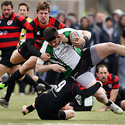 Action during the Middlesex V Morris (red and black) rugby match during the Four Leaf 15's Club Rugby Tournament at Randall's Island New York. The tournament included 70 teams in 6 divisions, organized by the New York City Village Lions RFC. Randall's Island, New York, USA. 23rd March. Photo Tim Clayton