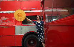 © Licensed to London News Pictures. 13/07/2014. London, UK.  Patricia Jordan and her greyhound Ruis enjoy the event at Finsbury Park, north London, which  commemorates the 60th anniversary of the unveiling of the first Routemaster, RM1, at the Commercial Motor Show in September 1954 . Photo credit : Isabel Infantes/ LNP