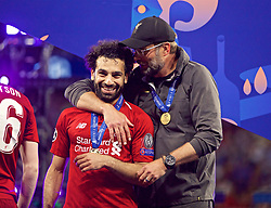 MADRID, SPAIN - SATURDAY, JUNE 1, 2019: Liverpool's manager Jürgen Klopp celebrates with Mohamed Salahafter the UEFA Champions League Final match between Tottenham Hotspur FC and Liverpool FC at the Estadio Metropolitano. Liverpool won 2-0 tp win their sixth European Cup. (Pic by David Rawcliffe/Propaganda)