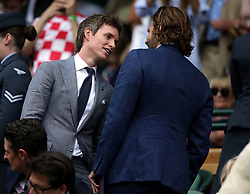 Bradley Cooper (right) and Eddie Redmayne in the royal box of centre court on day thirteen of the Wimbledon Championships at The All England Lawn Tennis and Croquet Club, Wimbledon.