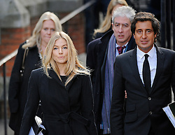 © London News Pictures. 24/11/2011. London, UK.  Actress SIENNA MILLER  arriving at The Royal Courts of Justice today (24/11/2011) with DAVID SHERBORNE  QC to give evidence at the Leveson Inquiry into press standards. The inquiry is being lead by Lord Justice Leveson and is looking into the culture, and practice of the UK press. Photo credit : Ben Cawthra/LNP