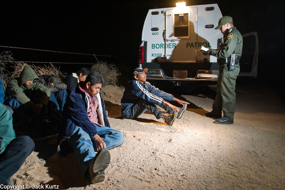 30 MARCH 2004 -- DOUGLAS, AZ: A Border Patrol agent processes a group of undocumented immigrants apprehended near Douglas, AZ. PHOTO BY JACK KURTZ