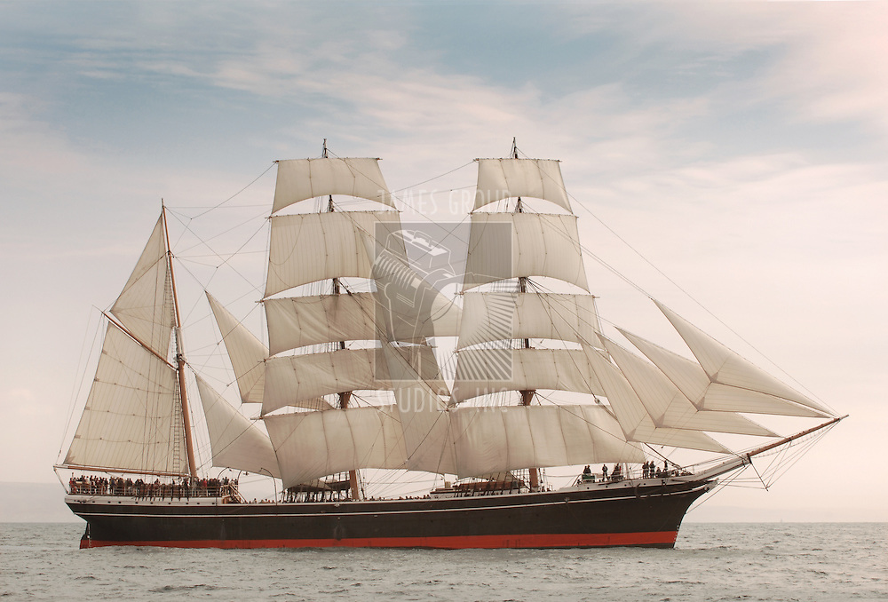 Vintage windjammer style ship with full sails on the open sea