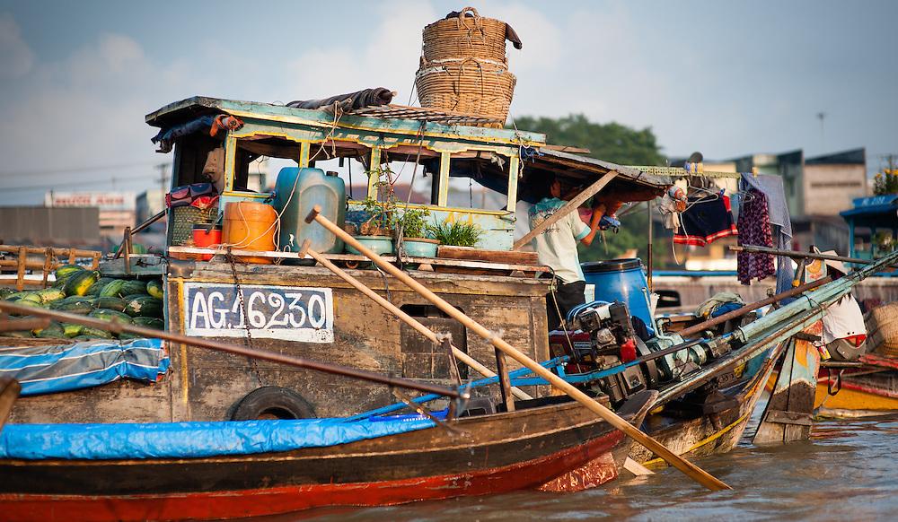 Fruit seller at floating market on Mekong Delta (Vietnam)