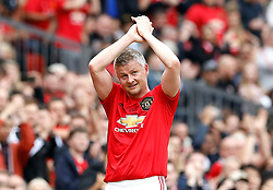 Manchester United Legends Ole Gunnar Solskjaer applauds the fans as he is substituted during the legends match at Old Trafford, Manchester.