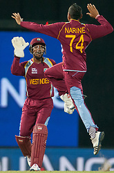 © Licensed to London News Pictures. 05/10/2012. West Indian Sunil Narine celebrates after getting the wicket of Matthew Wade during the World T20 Cricket Mens Semi Final match between Australia Vs West Indies at the R Premadasa International Cricket Stadium, Colombo. Photo credit : Asanka Brendon Ratnayake/LNP