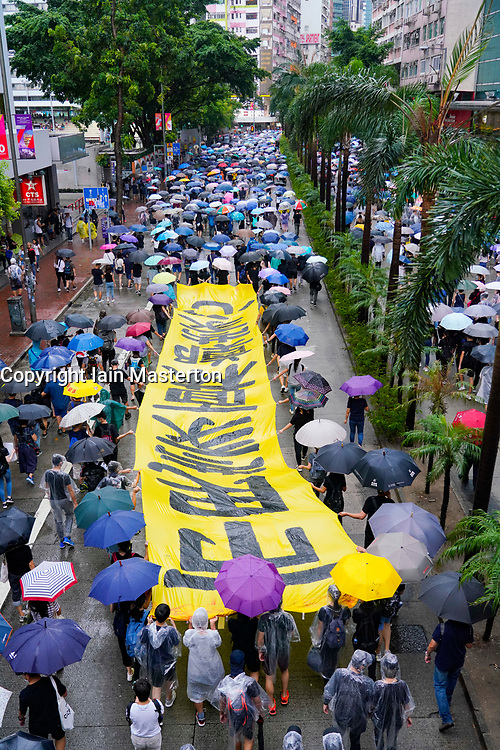 Hong Kong. 6 October 2019. Tens of thousands of pro-democracy protestors march in pouring rain through centre of Hong Kong today from Causeway Bay to Central. Peaceful march later turned violent as a hard-core of protestors confronted police.  Iain Masterton/Alamy Live News.