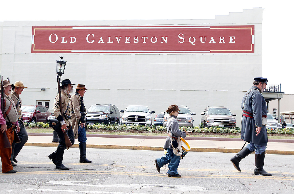 Participants dressed as Confederate soldiers pass through Old Galveston Square during a Battle of Galveston reenactment on the Strand in Galveston, Texas on Sunday, Jan. 15, 2012. The Battle of Galveston Reenactment was part of a series of events marking the 149th anniversary of the Civil War Battle of Galveston, in which Confederate troops regained control of Galveston Harbor.