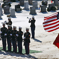 Fellow Marines pay tribute at the cemetery.
