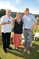 Left to right, VISCOUNT & VISCOUNTESS GORMANSTON and her son HARRY GRENFEL at a cricket match to in aid of CARE - Corfu Animal Rescue Establishment held at Hawkley Cricket Club, Hawkley, Hampshire on 8th September 2012.
