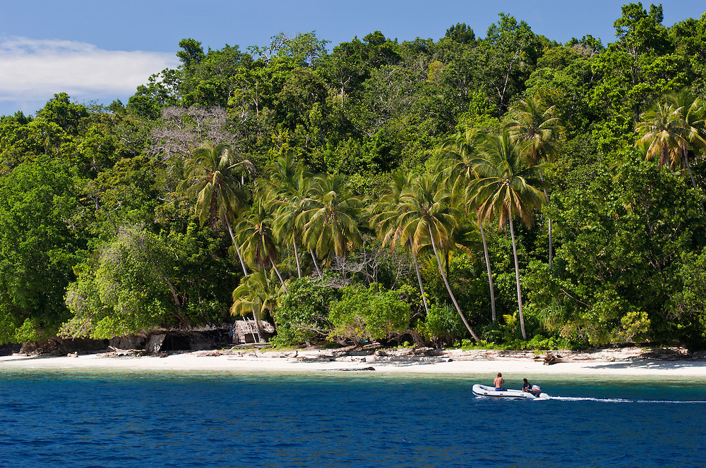Tourists exploring the coastline of a remote island, Rurbas, West Papua, Indonesia.
