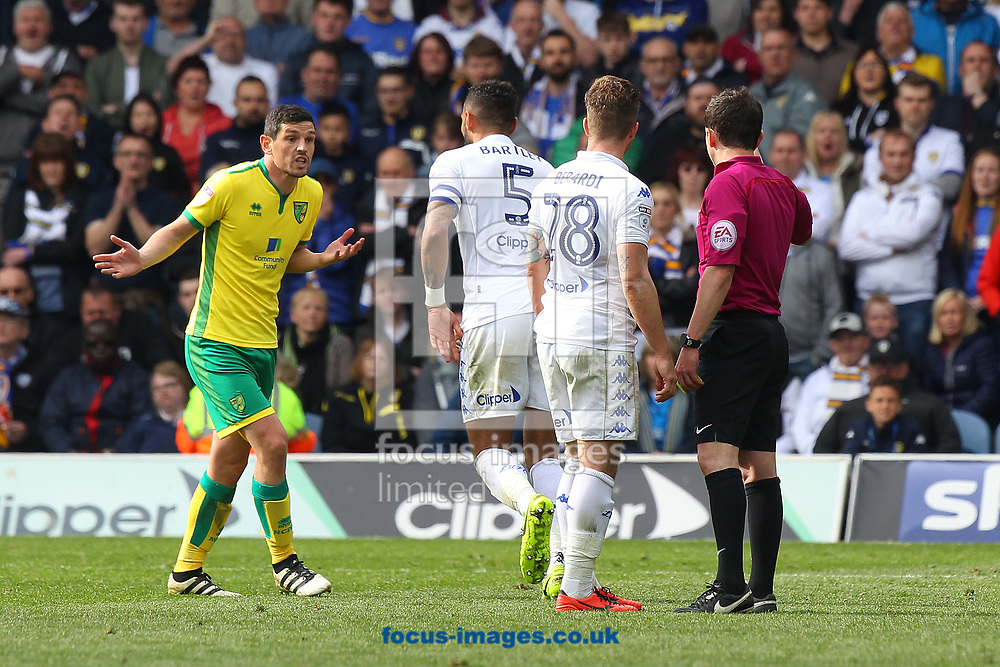 Graham Dorrans of Norwich carries on protesting his innocence after getting a yellow card from Referee Tony Harrington after his clash with Gaetano Berardi of Leeds United during the Sky Bet Championship match at Elland Road, Leeds<br /> Picture by Paul Chesterton/Focus Images Ltd +44 7904 640267<br /> 29/04/2017