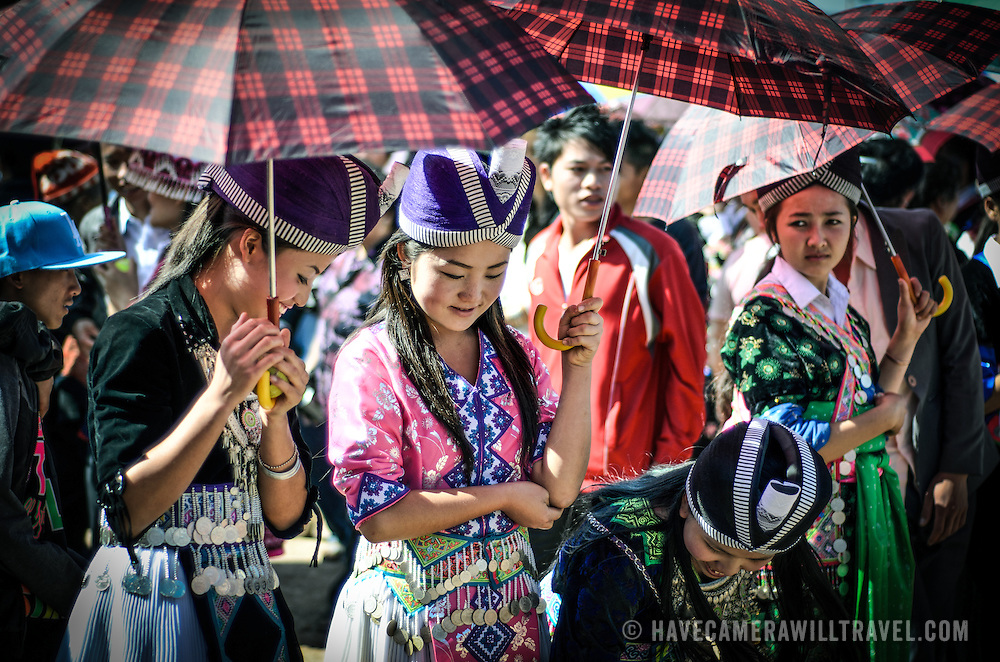Young Hmong men and women flock to the New Year festival in in Phonsavan in northeastern Laos. Hmong girls dress in brightly colored costumes and engage ball games of catch as part of a ritual traditionally designed to find husbands. The people of the region are predominantly of Hmong ethnicity.