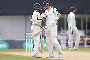 Yorkshire All-rounder Adil Rashid celebrates his 50 half century with Yorkshire Batsman Joe Root during the Specsavers County Champ Div 1 match between Yorkshire County Cricket Club and Surrey County Cricket Club at Headingley Stadium, Headingley, United Kingdom on 10 May 2016. Photo by Simon Davies.