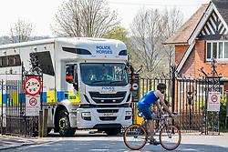 © Licensed to London News Pictures. 10/04/2020. London, UK. A police lorry at the gates at Richmond Park which is still closed to cyclist and cars as the police attempt to reduce numbers of people going out over the Easter Bank Holiday with temperatures expected to reach 25c. Richmond Park would normally be packed on a sunny Bank Holiday weekend with sunbathers, walkers, runners and families, remains relatively empty as tough policing keeps people away during the lockdown as the coronavirus crisis continues. Photo credit: Alex Lentati/LNP