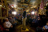 Republican presidential hopeful Mitt Romney speaks during a campaign stop at the Galleria De Paco restaurant in Waterloo, Iowa, Monday, December 31, 2007.