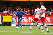 AFC Wimbledon attacker Michael Folivi (17) dribbling and taking on Rotherham United defender Joe Mattock (3) and Rotherham United midfielder Dan (Daniel) Barlaser (11) during the EFL Sky Bet League 1 match between AFC Wimbledon and Rotherham United at the Cherry Red Records Stadium, Kingston, England on 3 August 2019.