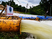 09 AUGUST 2018 - KAENG KRACHAN, PHETCHABURI, THAILAND: Flood water flows out of a temporary spillway on the Kaeng Krachan Dam. The Phetchaburi River flows from Kaeng Krachan Dam to the Gulf of Siam through several towns including Ban Lat, Phetchaburi (the capital of Phetchaburi province) and Ban Laem. Government officials have warned residents of those towns that their towns will flood because the reservoir behind the dam is approaching capacity. Ban Lat and Phetchaburi could be flooded for several weeks. Residents of Ban Laem have been warned that their community could be inundated for over a month. Dams in Kanchanaburi province, west of Phetchaburi, are also approaching capacity and flooding is also expected in that area.   PHOTO BY JACK KURTZ