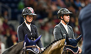 AMY MILLAR (CAN) rides Heros during the prize giving ceremony of the Greenhawk Canadian Championship at The Royal Horse Show in Toronto, Ontario. MILLAR finished 5th, behind her brother (right) JONATHON MILLAR  who finished 4th riding Bonzay